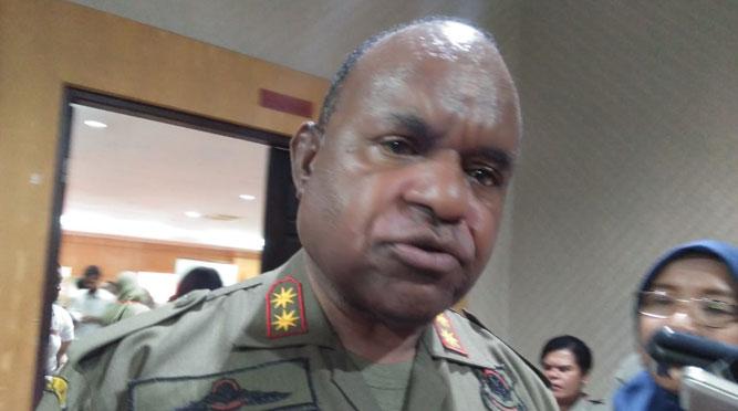 Asisten Bidang Pemerintahan, Hukum dan HAM Setda Papua, Doren Wakerkwa, SH