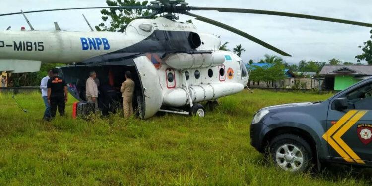 Helikopter  Jenis MI-8MTV-I dengan Nomor Registrasi UP-MI815  Milik BNPB Mendarat Darurat di Lapangan Sepak Bola Kampung Benyom Jaya I, Distrik Nimbokrang, Kabupaten Jayapura, Minggu (7/2/2021) sekitar pukul 09.00 WIT akibat cuaca buruk.